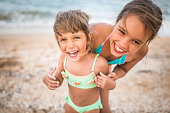 Children are fooled at sea shore