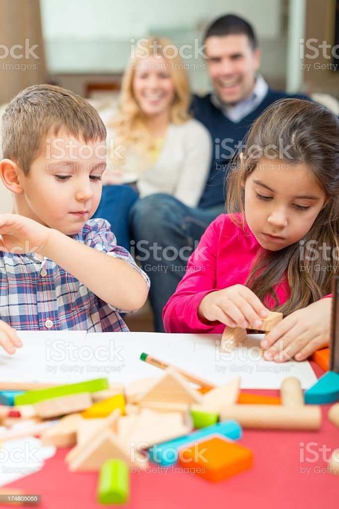 Children are playing with wooden blocks. royalty-free stock photo
