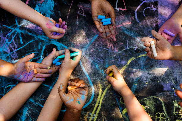 Children art drawing together stock photo