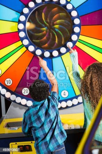 istock Children at an amusement arcade 493613507