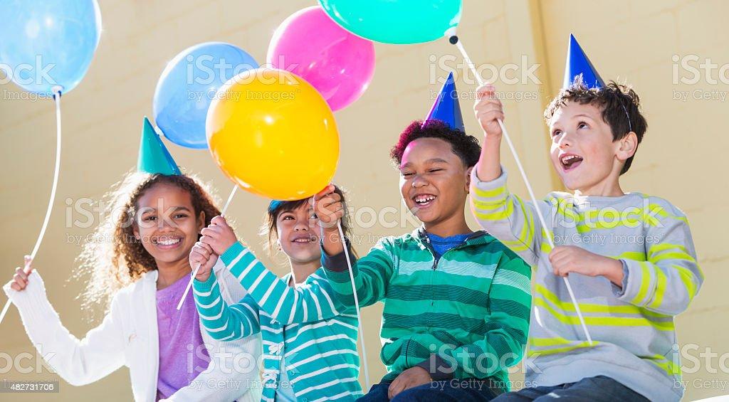 Children at birthday party having fun stock photo