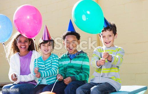 istock Children at birthday party 467634970