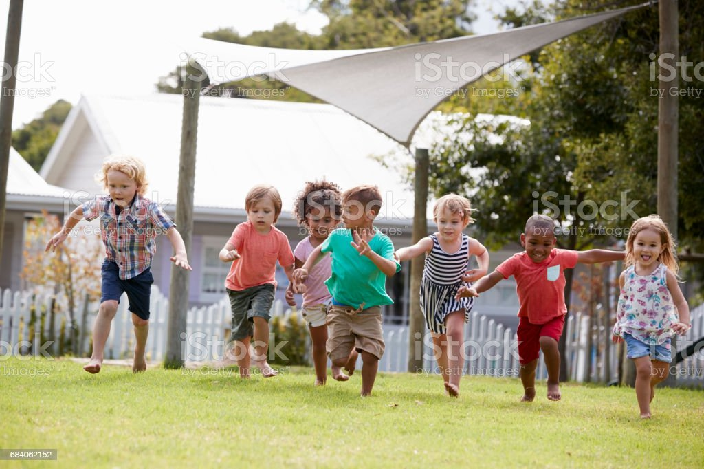 Children At Montessori School Having Fun Outdoors During Break royalty-free stock photo