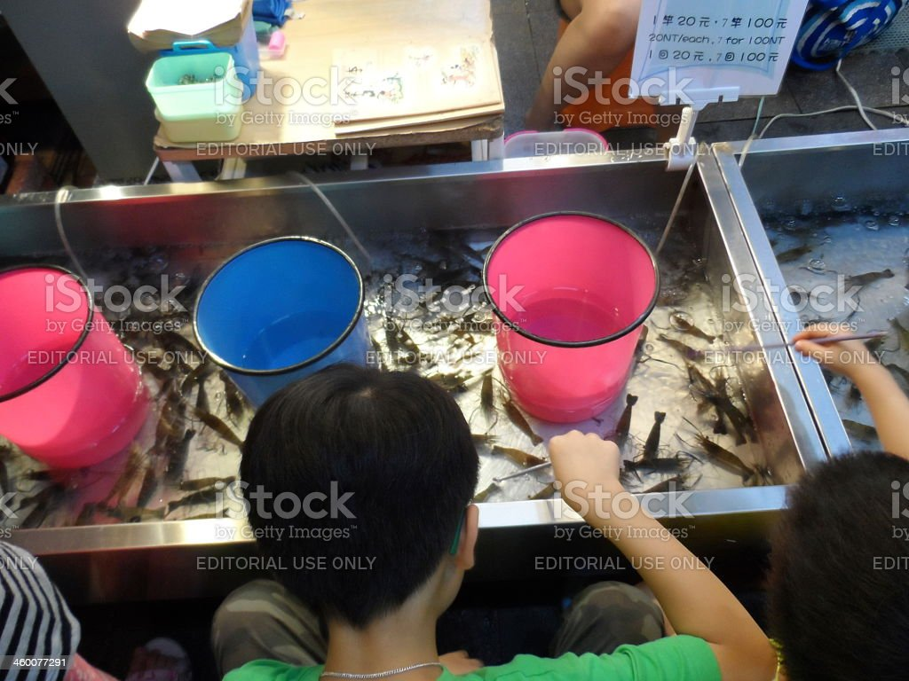Children at night market in Taiwan royalty-free stock photo
