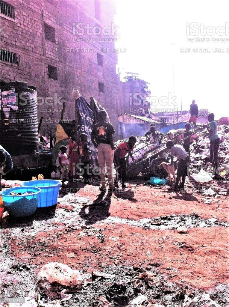 Children at rubbish heap in African slum stock photo