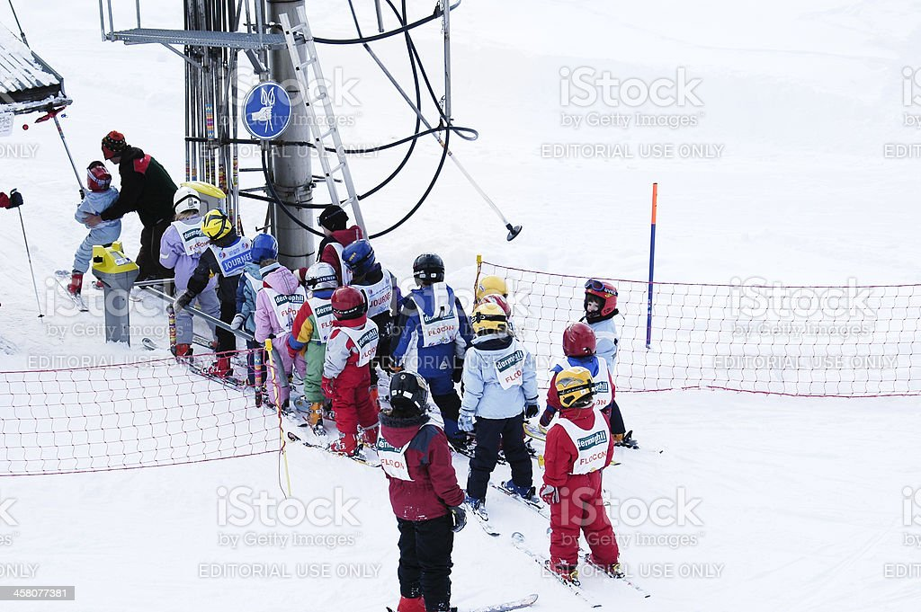 Children at the chairlift stock photo