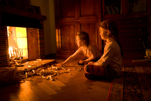 Children At The Fireplace Stock Photo - Download Image Now