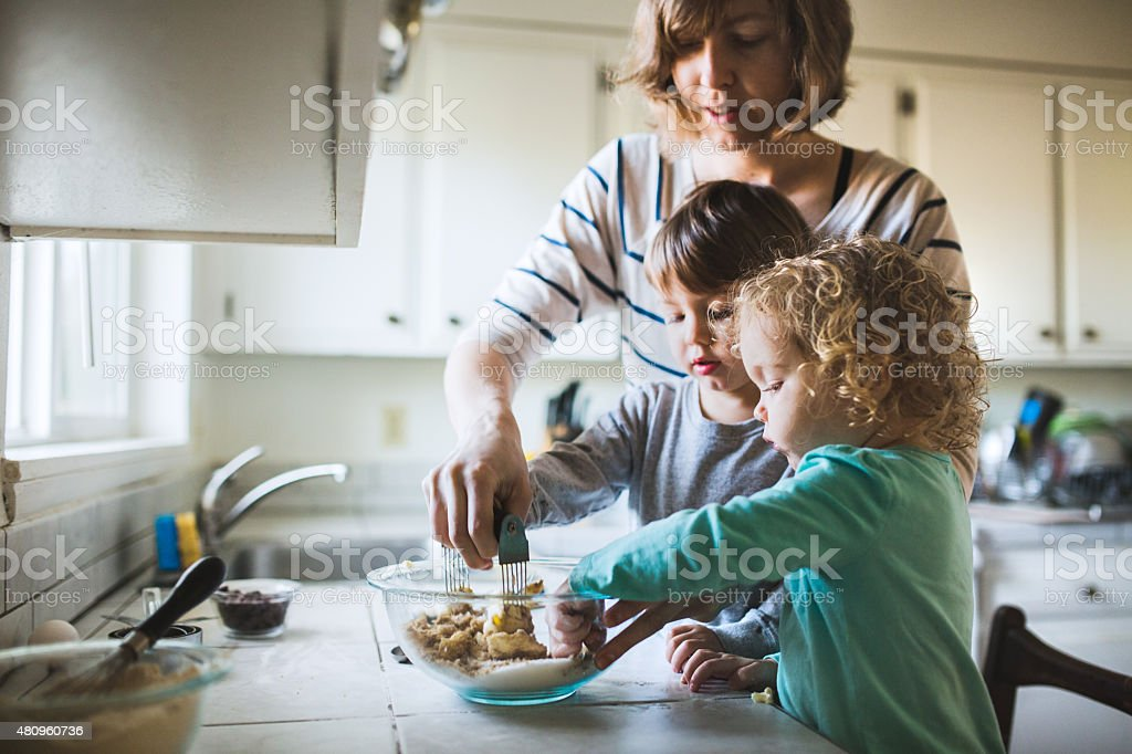 Children Baking Cookies with Mom stock photo