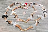 Children ballerinas group making heart with their bodies