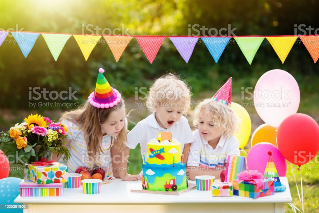 Children Blow Candles On Birthday Cake Kids Party Stock Photo More