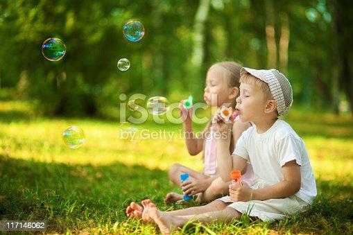istock Children blowing bubbles 117146062
