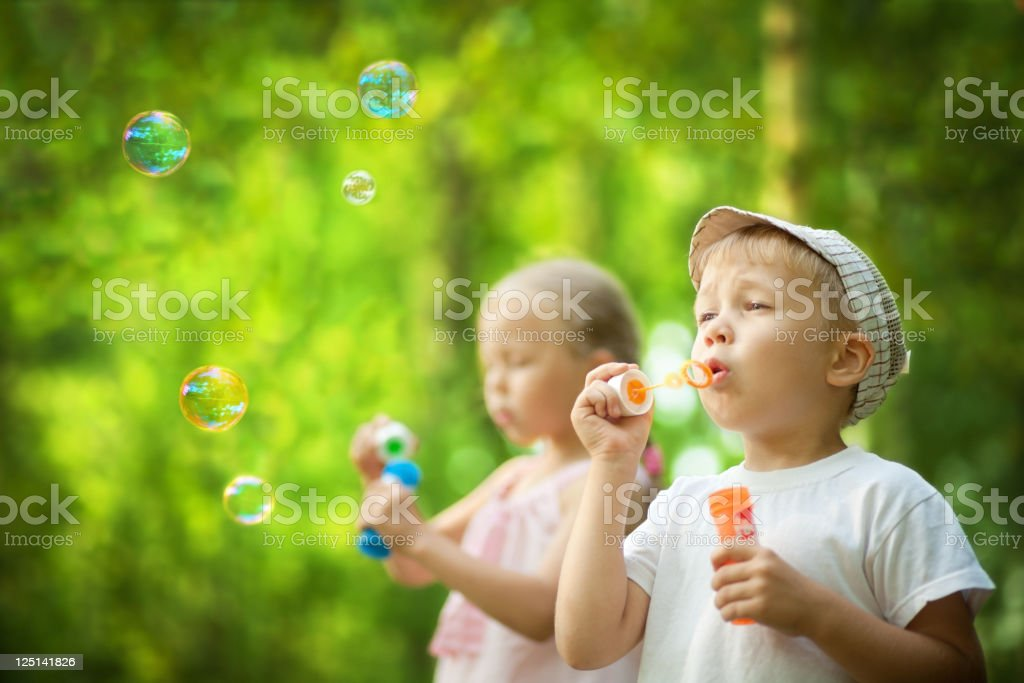 Children blowing bubbles royalty-free stock photo