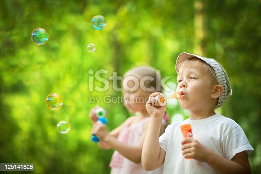 507271044istockphoto Children blowing bubbles 125141826