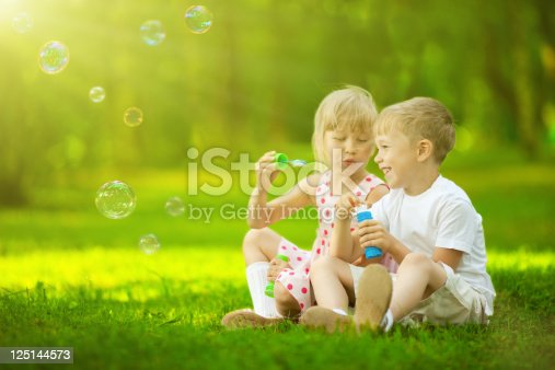 507271044istockphoto Children blowing bubbles 125144573