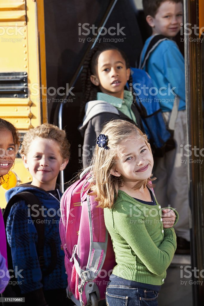 Children boarding school bus stock photo