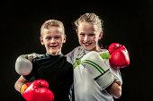Children boxing for fun.