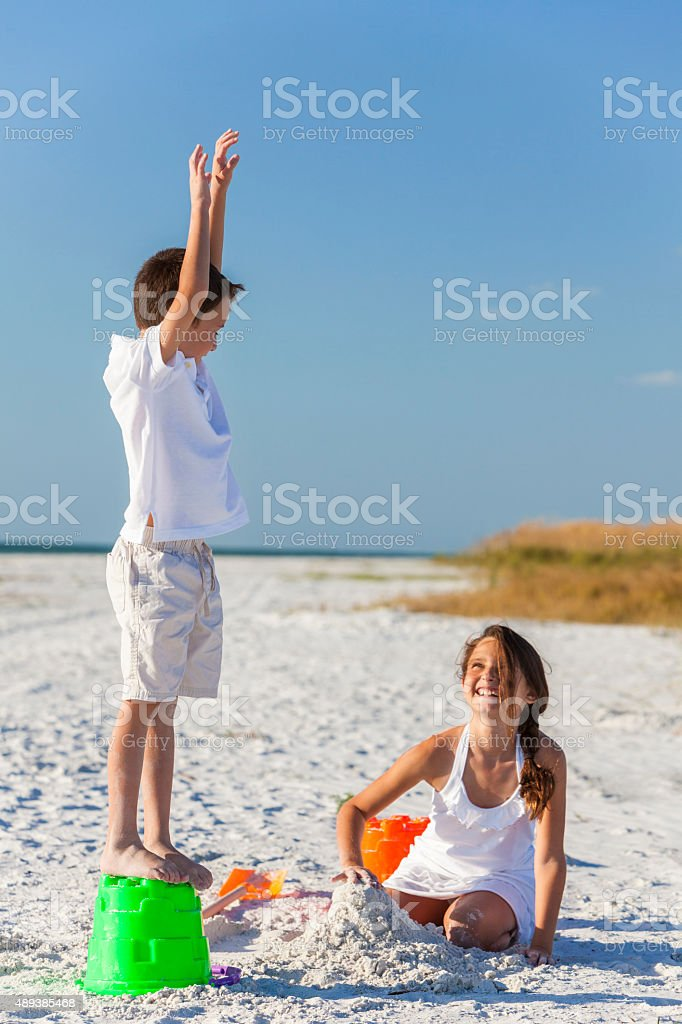 Children, Boy, Girl, Brother & Sister Playing on Beach stock photo