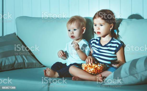 Children brother and sister watching tv in evening picture id683821088?b=1&k=6&m=683821088&s=612x612&h=0sdtnr5uthekzu5aopj0zjq5trwif2oc2vsygiyts e=