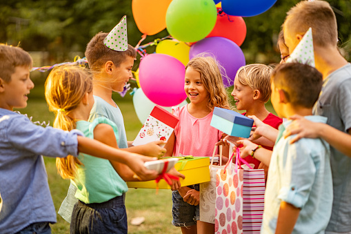 Group of children at birthday partu in public park