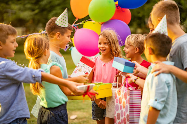 Children came to birthday party with presents Group of children at birthday partu in public park birthday candle stock pictures, royalty-free photos & images