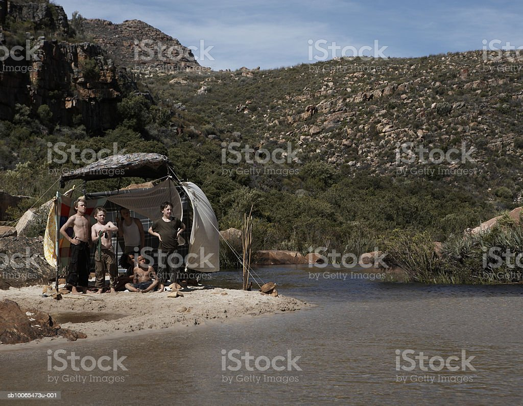 Children (6-13) camping by stream royalty-free stock photo