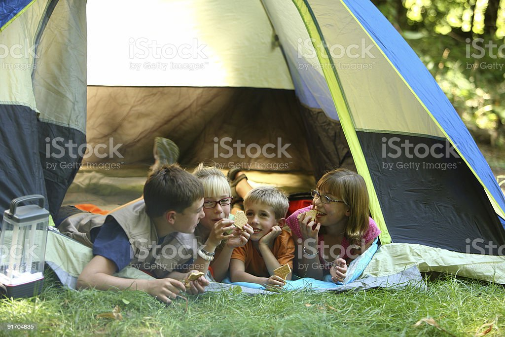 Children camping in tent royalty-free stock photo