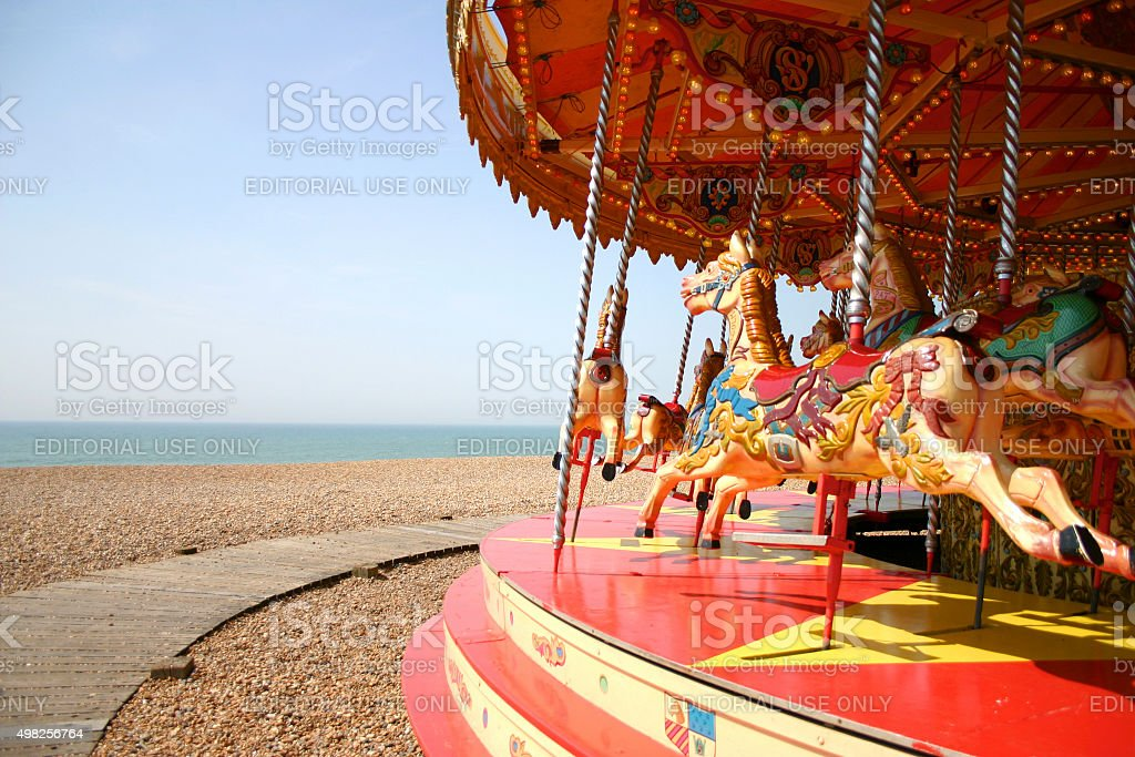 Children carousels standing on the beach, Brighton stock photo