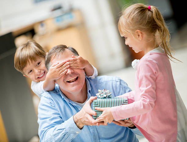 children celebrating father's day - fathers day stock photos and pictures