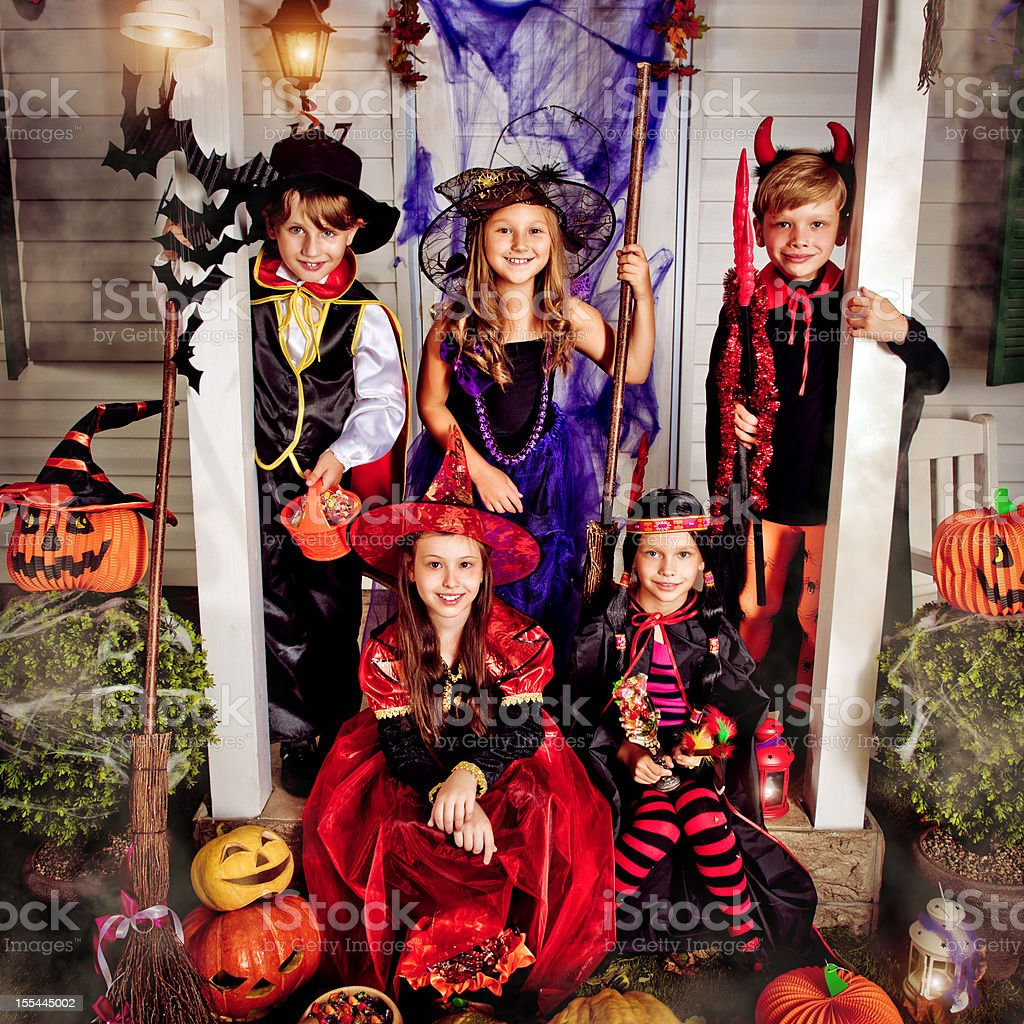 Children celebrating Halloween stock photo