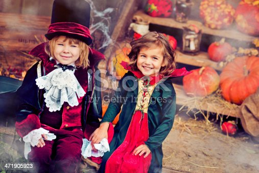 Little girl and boy at Halloween
