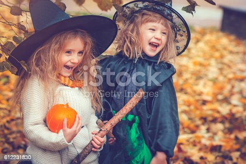 Little girls dressed as witch at Halloween
