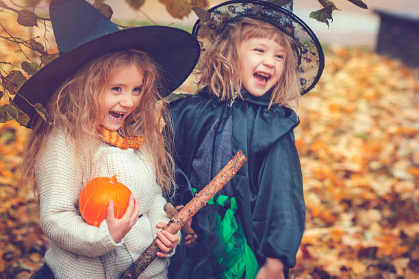 Children celebrating Halloween Little girls dressed as witch at Halloween costume stock pictures, royalty-free photos & images