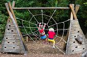 istock Children climb on school yard playground 679916098