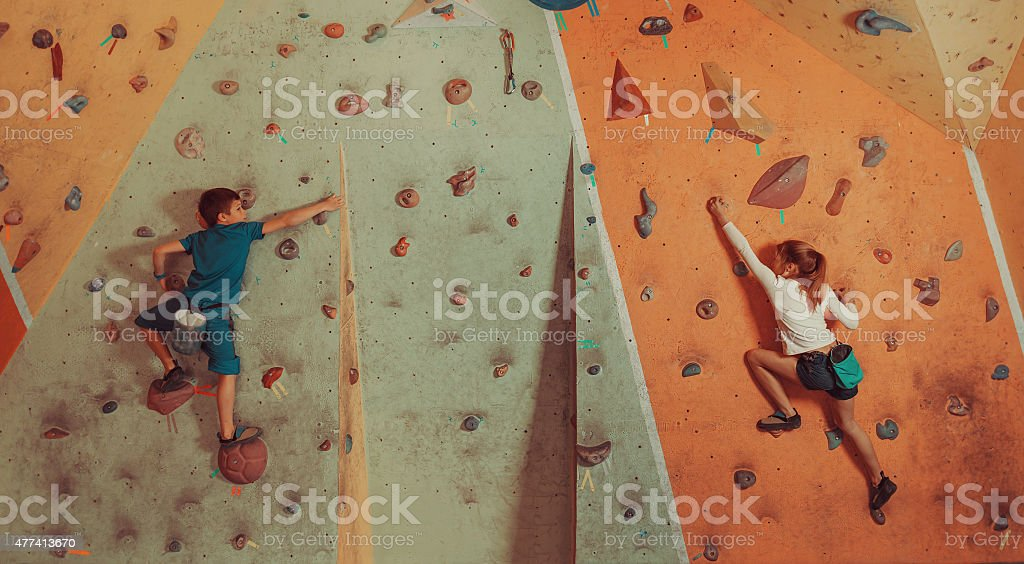Children climbing indoor stock photo