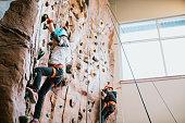 istock Children Climbing Indoor Rock Wall 1248550771
