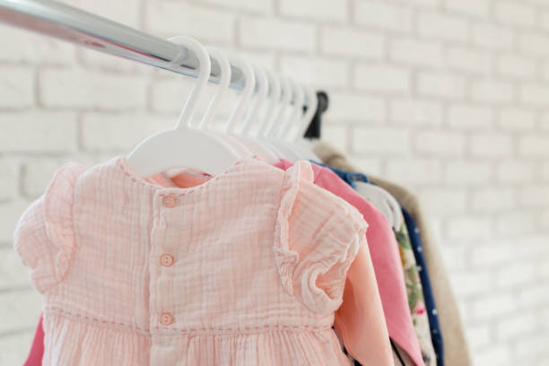 children clothes children clothes clothing stock pictures, royalty-free photos & images