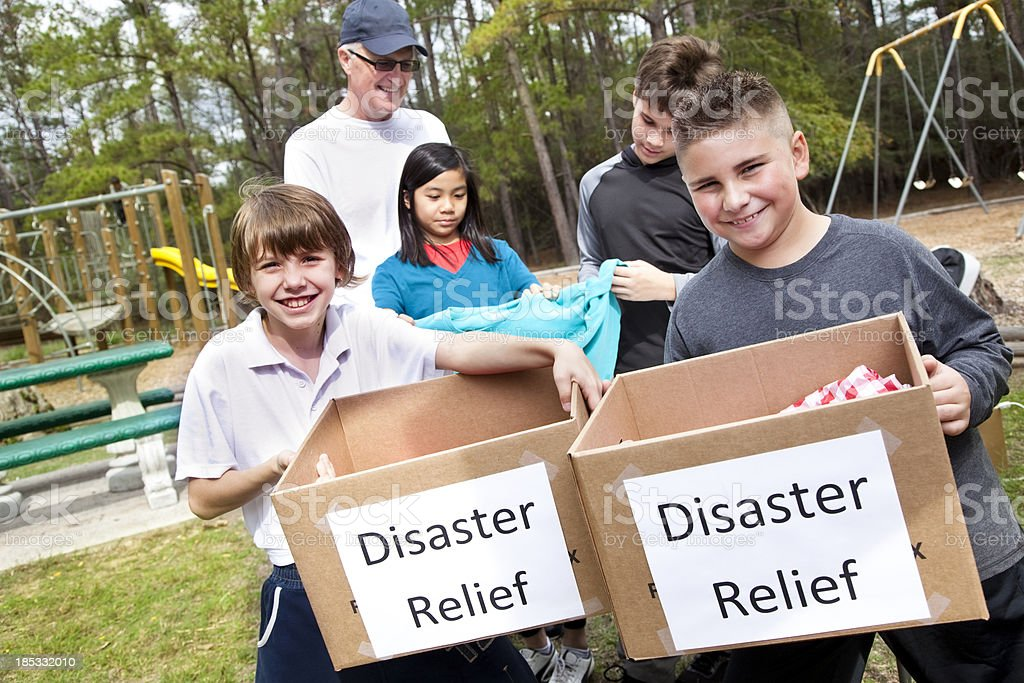 Children collecting for disaster victims stock photo