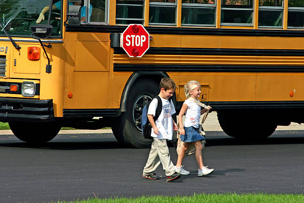 children coming home from school - school bus stock photos and pictures