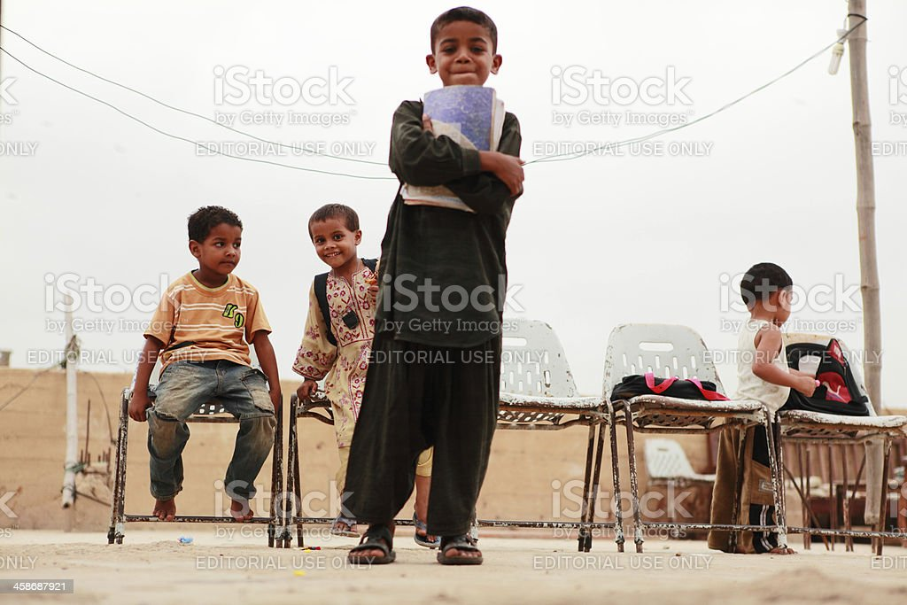 Children coming to Evening School in Lyari, Karachi stock photo