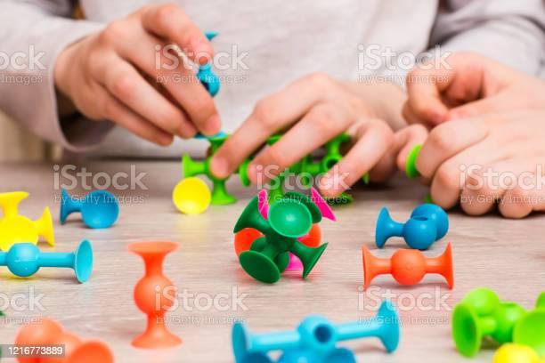 Children connect the details of the color designer on the table of picture id1216773889?b=1&k=6&m=1216773889&s=612x612&h=ooi9wt2qtq dmsuvegdet e1ziztbbxzu0e6tgupl58=