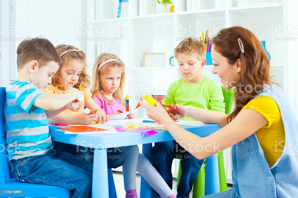 Children Craft Activities with color paper and glue. royalty-free stock photo
