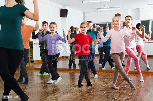 Friendly  children dancing contemp in studio smiling and having fun