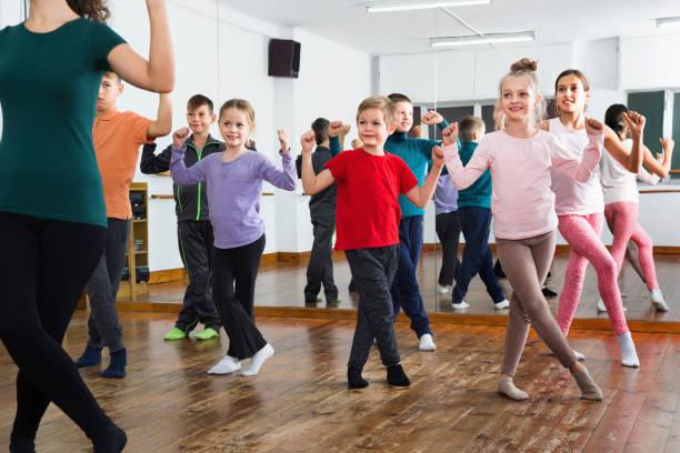 Children dancing contemp in studio smiling and having fun picture id967041640?b=1&k=6&m=967041640&s=612x612&w=0&h=hyitcu00ifxcwuxtsertmnuludmkexalg gtmfxr4ei=