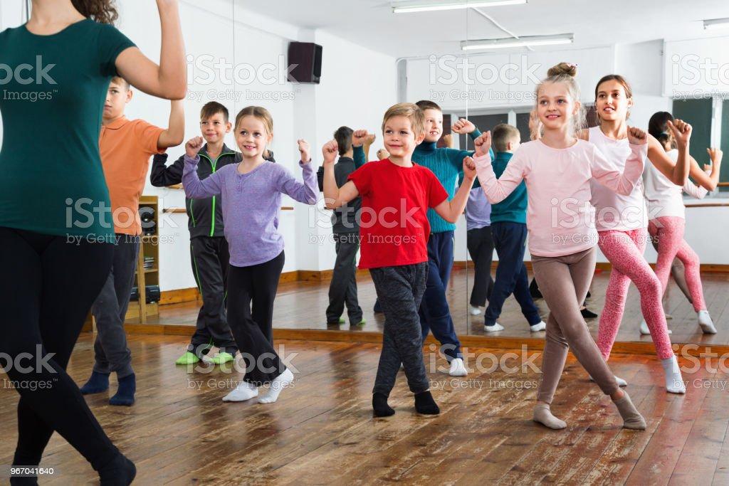Children dancing contemp in studio smiling and having fun stock photo