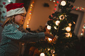 Children decorating Christmas tree.