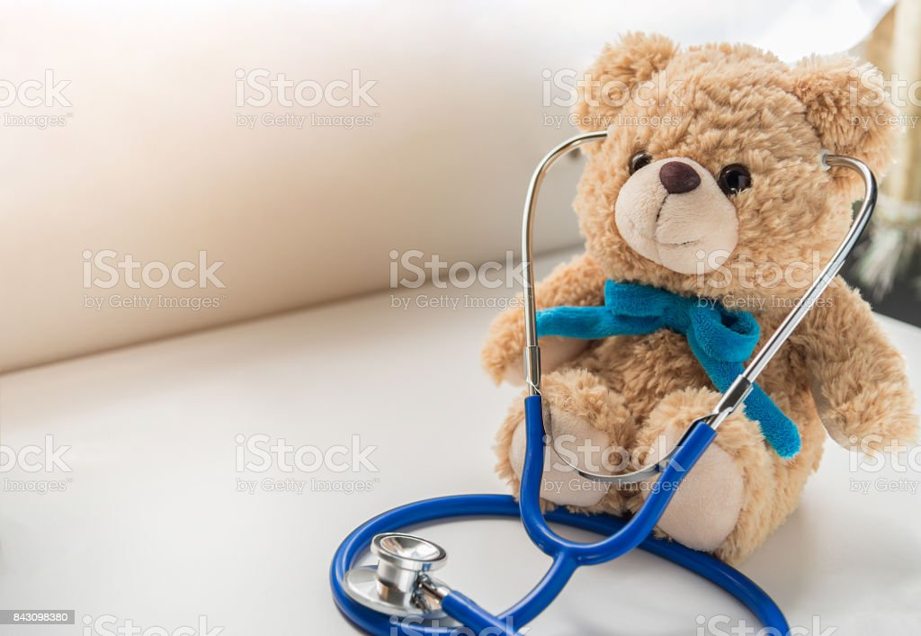 Children doctor concept - Teddy Bear with stethoscope. copy space stock photo
