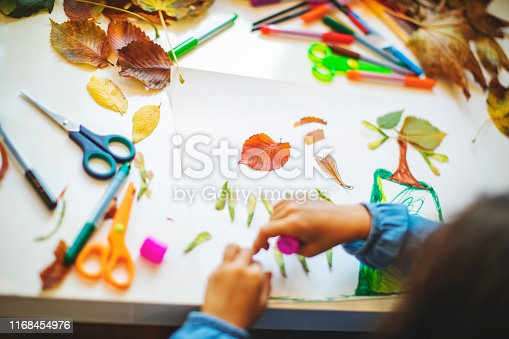 Children doing autumn handcrafts