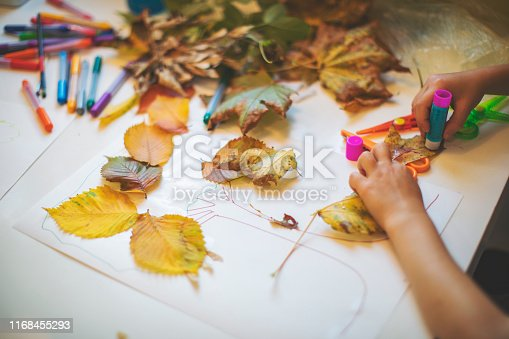 Children doing autumn handcrafts
