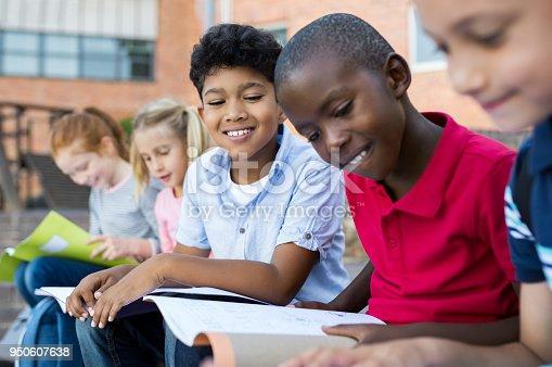 istock Children doing homework outdoor 950607638