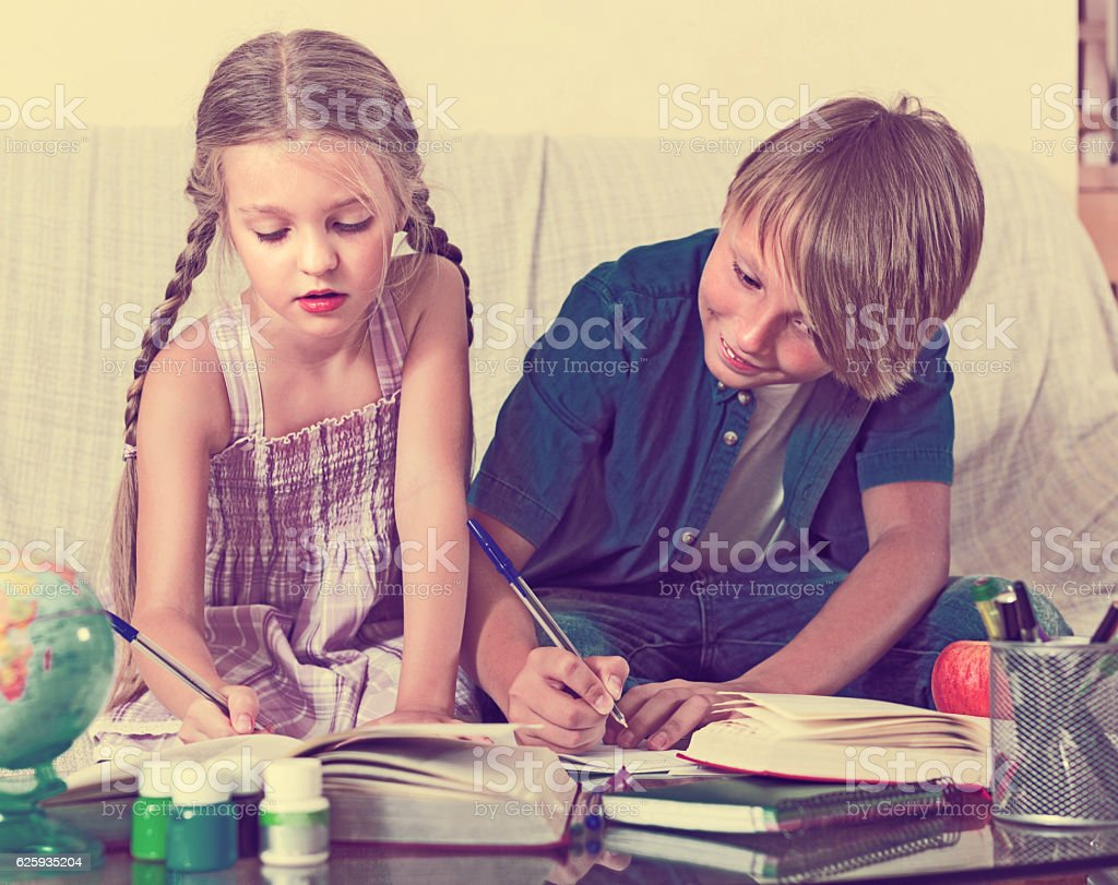 Children doing homework stock photo